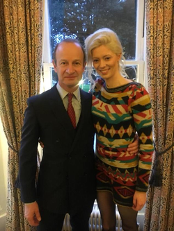 With Henry Bolton