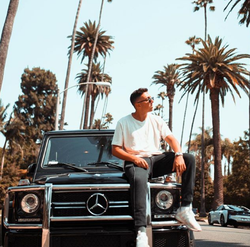 Sitting on a Mercedes Benz​ in Beverly Hills, California​