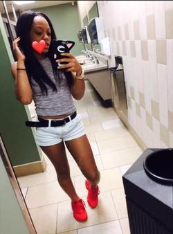 Tysiona Crawford taking a bathroom selfie