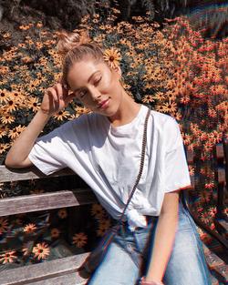 Photo of                               Jourdan Sloane                              taken while she sits at a bench.