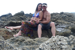 Sara Carter and her husband Marty Bailey sitting by the beach