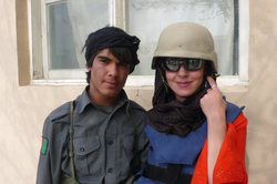 Sarah Carter with a 15-year-old police officer in                               Afghanistan                              