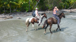 Sara Carter and Marty riding horses in                               Costa Rica                              