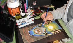 Photo of                               Dominick Cabalo                              working on one of the illustrations for his son.