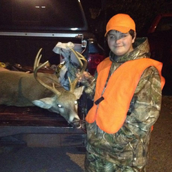 Gage Smock after a deer hunt [2]​