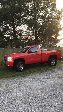 Gage's red Chevrolet Silverado​ [2]​