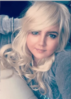 Photo of Danni Tamburo with blonde hair.