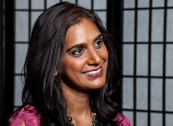 Asha Rangappa smiling