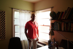 Photo of Light Watkins taking while inside of house of a client.