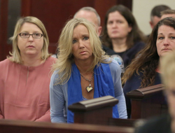 Photo of                               Tami Bella                              sitting up front during the trial concerning the murder of daughter                               Nicole Lovell                              ​.