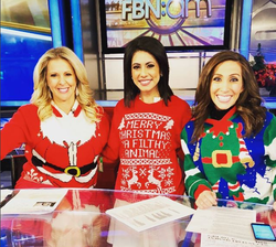Lauren Simonetti wearing ugly Christmas sweaters with her co-hosts.                                                                  [13]                                                               ​
