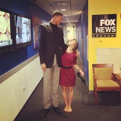 Photo of Lauren Simonetti next to professional basketball player,Isaiah Austin.[13]