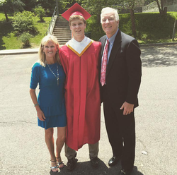 Photo of                               John Rigsby                              with his parents on his high school graduation day.