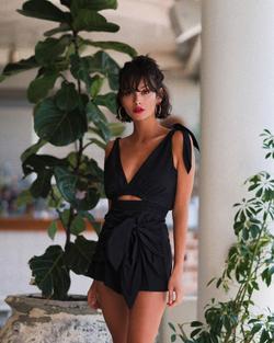 Taylor Lashae wears a black dress.