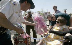 Lt. Paul Bauer presents several gifts to Kira Mammoser, 11, including a pink pony on behalf of the Police Mounted Unit in this May 2013 photo. | Sun-Times file photo [2]​