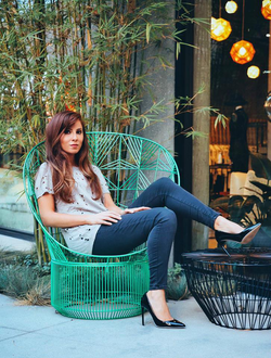 Sitting in a green chair