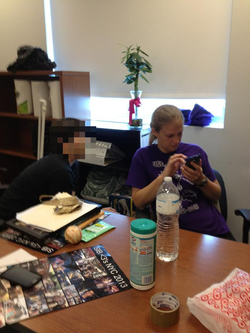 Melissa Bonkoski with a student at her desk [8]​