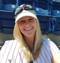 Melissa Bonkoski wearing her Philadelphia Phillies baseball jersey at a game​ [4]​​