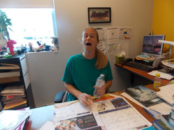 Melissa Bonkoski at her desk as a teacher [8]​
