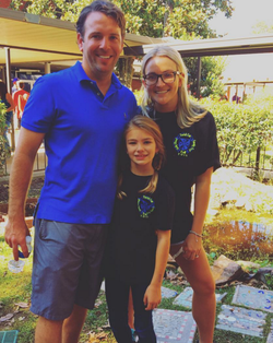 Maddie with her parents.