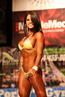 Michelle competing at a bodybuilding competiton