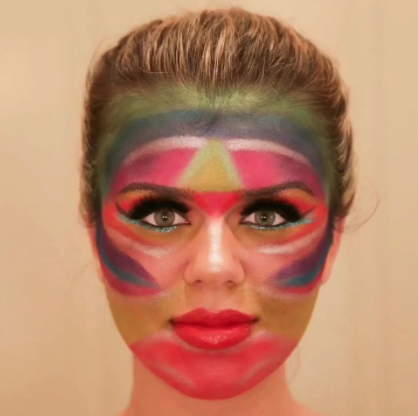 Mikaela's colorful made-up face.
