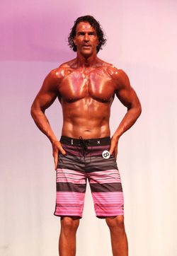 Sean Grove                              as a participant at a body sculpting competition.