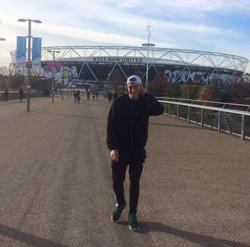 Photo of                               Ben Kebbell                              outside of a stadium.
