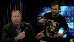 Image of                               Rob Jacobson                              with                               Alex Jones                              ​ during the moments when he is told to leave the set of the shot                               InfoWars                              ​.