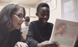 Karen Mallard with a student from one of her early elementary reading classes.