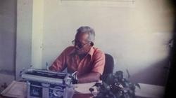 Francisco Antonio Cerda Santos, in a desk, while writing on his typewriter.