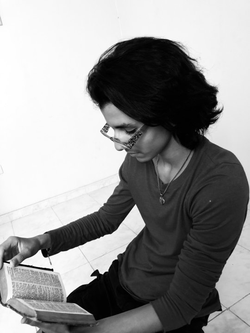 Emil Cerda reading the Bible, in the house of his friend Yunel Contreras. Photo taken by his friend Juan Miguel Peña.