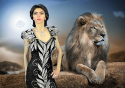 Nasim posing with a lion in the background