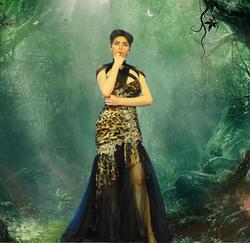 Nasim Aghdam wearing a dress [9]