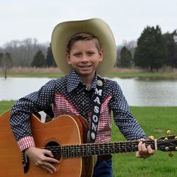 Mason Ramsey pictured with his guitar