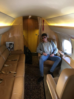 Nick Filchy sitting on a private jet
