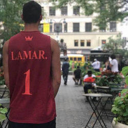 Sean wearing a LAMAR. jersey