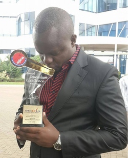 Ferdinand Omondi with an award