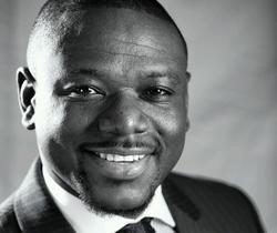 Akwasi Sarpong smiling