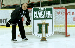 Photo of                               Darcy Haugan                              with a championship trophy.