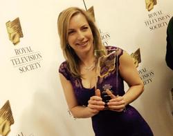 Emma Vardy with an award