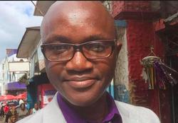 Umaru Fofana wearing glasses