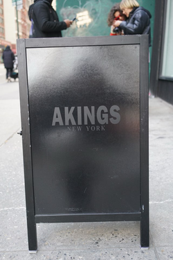 AKINGSNY signage at NYFW popup in SoHo