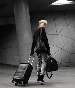 Alan in AKINGSNY Denim, Tote bag, and custom luggage.