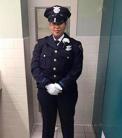 Photo of Maria Velez in her full police uniform[7]