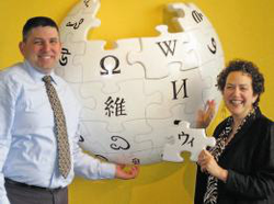 Davida Walsh (right) pictured next to the                               Wikipedia                              ​ logo