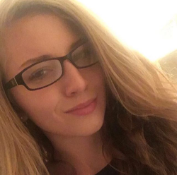 Lauren Emily Pearson wearing glasses [6]​