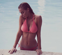 Photo of Elizabeth Turner getting out of a pool [5]​