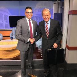 With                               Pat Buchanan                               on the set of                               The McLaughlin Group                              