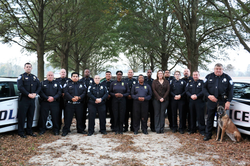 Frank Moss, pictured far right, in a photo with the Warsaw Police Department [5]​